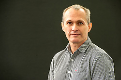 Pictured: David Vann<br /> <br /> David Vann was born October 19, 1966 on Adak Island in the Aleutian Islands, Alaska. He is a novelist and short story writer, and is currently a professor of creative writing at the University of Warwick in England.<br /> <br /> <br /> Book fanatics headed to Charlotte Square in Edinburgh which is the hub of the international Book Festival to meet the authors and also to meet up with fellow fans of the printed word.<br /> <br /> 27 August 2017