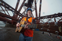 Bwani Junction, the Edinburgh based band, made music history by becoming the first group to play on the Forth Rail Bridge, they played on the highest point of the 122-year-old structure. Dan Muir. Rory Fairweather (singer)..©Michael Schofield.