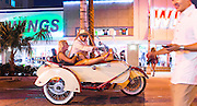 A couple on a motorcycle with sidecar on Miami Beach's Lincoln Road, near the main exhibition hall and several satellite art fairs during Art Basel Miami Beach 2012