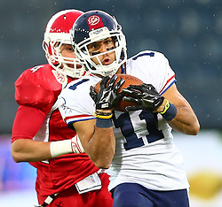 02.06.2014, UPC Arena, Graz, AUT, American Football Europameisterschaft 2014, Gruppe B, Daenemark (DEN) vs Frankreich (FRA), im Bild Andreas  Schneider, (Team Denmark, LB, #4) und  Guillaume  Rioux , (Team France, WR , #11) // during the American Football European Championship 2014 group B game between Denmark and France at the UPC Arena, Graz, Austria on 2014/06/02. EXPA Pictures © 2014, PhotoCredit: EXPA/ Thomas Haumer