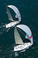 Two yachts compete in team sailing event California