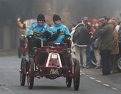 © Licensed to London News Pictures. 01/11/2015. Staplefield, UK. A 1901 Renault motors through Staplefield during the London to Brighton Veteran Car Run.  Photo credit: Peter Macdiarmid/LNP