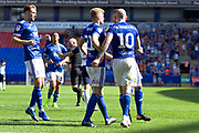 Ipswich Town midfielder James Norwood celebrates his goal with team-mates during the EFL Sky Bet League 1 match between Bolton Wanderers and Ipswich Town at the University of  Bolton Stadium, Bolton, England on 24 August 2019.