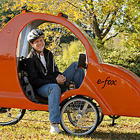 Jesse Stephenson, developer of the e-fox, poses for a photograph with the e-fox, an electric assisted, human powered vehicle at NuWay2Commute on Monday, Nov. 4, 2013 in Wilmington, N.C. Photo by Michael Cline Photography