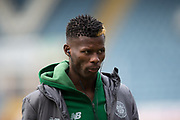 17th March 2019, Dens Park, Dundee, Scotland; Ladbrokes Premiership football, Dundee versus Celtic; Vakoun Issouf Bayo of Celtic inspects the pitch before the match