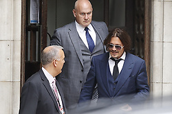 © Licensed to London News Pictures. 07/07/2020. London, UK. US actor Johnny Depp leaves The High Court in Central London. Johnny Depp's libel trial against The Sun newspaper is due to take place over the next three weeks over allegations he was violent and abusive towards his ex-wife Amber Heard. Photo credit: Peter Macdiarmid/LNP