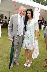 GEOFFREY KENT and his wife OTAVIA at the 2013 Cartier Queens Cup Polo at Guards Polo Club, Berkshire on 16th June 2013.