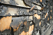 Charred siding at the site of the May 3 fire on Pierce Street in Lewiston, Maine on May 17, 2013. The fire was the second of three arsons in one week within three blocks of each other in downtown Lewiston.