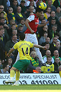Picture by Paul Chesterton/Focus Images Ltd.  07904 640267.19/11/11.Andre Santos of Arsenal and Wes Hoolahan of Norwich in action during the Barclays Premier League match at Carrow Road stadium, Norwich.