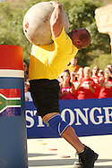 Jason Bergmann (USA) extends his entire body to place the final and heaviest of 5 Atlas Stones on top of the platform during the final rounds of the World's Strongest Man competition held in Sun City, South Africa.