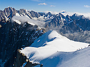 See the Needles of Chamonix (Aiguilles du Chamonix) and Mont Blanc massif from spectacular Aiguille du Midi station (12,600 feet) on the téléphérique (cable car, aerial tramway, or Seilbahn) from Chamonix (3300 feet elevation), France, the Alps, Europe.