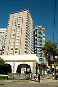 Downtown apartment blocks in Vancouver West End Robson Street shopping area.  Vancouver BC, Canada.