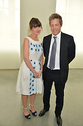 HUGH GRANT and GABBY DEEMING at a lunch in aid of the charity African Solutions to African Problems (ASAP) held at the Louise T Blouin Foundation, 3 Olaf Street, London W11 on 21st May 2014.