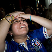 Date: 6/11/10..One of the few Mexican fans in the room reacts to a near-goal by Mexico during the 2010 World Cup opening Group A match between South Africa and Mexico at Madiba, a South African restaurant in Fort Greene, Brooklyn on June 11, 2010.   The game finished in a 1-1 tie. ..Photo by Angela Jimenez for Newsweek .photographer contact 917-586-0916/angelajime@gmail.com