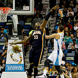 Dec 22, 2012; New Orleans, LA, USA; New Orleans Hornets shooting guard Austin Rivers (25) shoots over Indiana Pacers center Roy Hibbert (55) during the second quarter of a game at the New Orleans Arena. Mandatory Credit: Derick E. Hingle-USA TODAY Sports