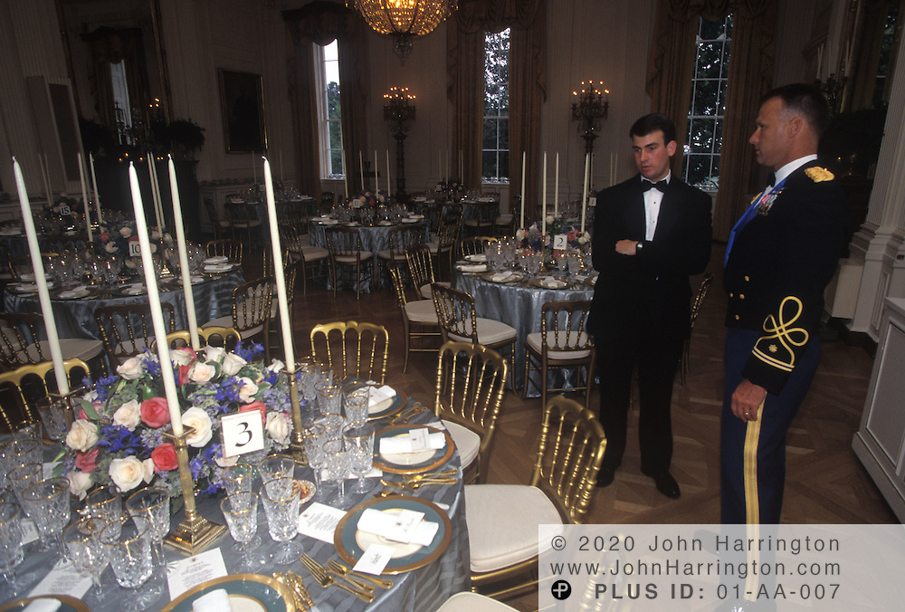 A General chats with an aide before the State Dinner.