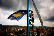 Raising the new Kosovo flag above Shtime four months after the declaration of independence. June 2008.
