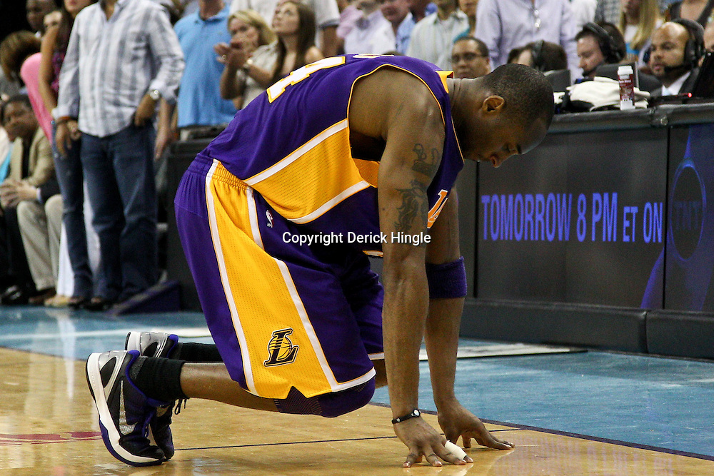 April 24, 2011; New Orleans, LA, USA; Los Angeles Lakers shooting guard Kobe Bryant (24) on the floor after injuring his ankle during the fourth quarter in game four of the first round of the 2011 NBA playoffs against the New Orleans Hornets at the New Orleans Arena. The Hornets defeated the Lakers 93-88.   Mandatory Credit: Derick E. Hingle