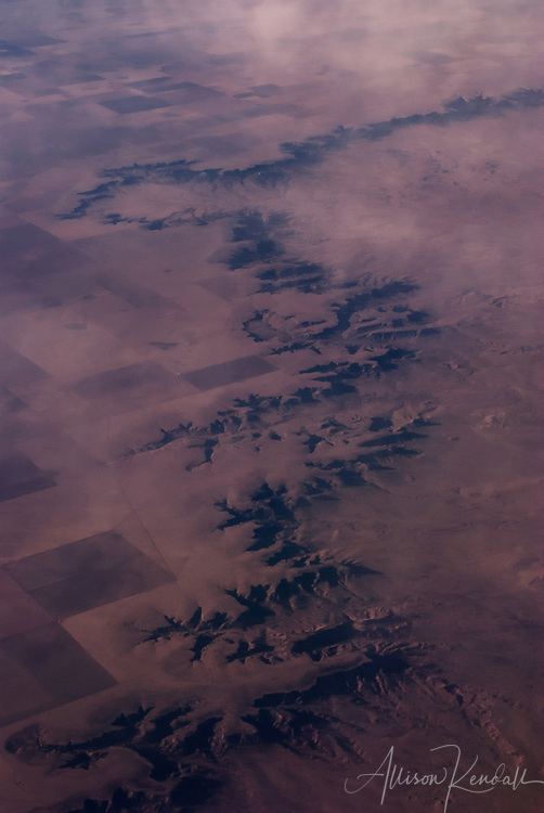 Aerial view of the arid western landscape, eroded cliffs and canyons cut through patchwork agricultural land fine art photography, art photography, fine art, prints, photo print, fine art prints, photography art prints,