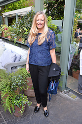 ASTRID HARBORD at a party to celebrate 'A Year In The Garden' celebrating the first year of The Ivy Chelsea Garden, 197 King's Road, London on 16th May 2016.