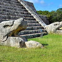 El Castillo Northern Staircase at Chichen Itza, Mexico <br /> El Castillo has a staircase on each side featuring 91 steps. On top is the 365th step, representing the days of the year. The Mayan's mastery of astrology also influenced the pyramid's design. During the spring and winter equinox, a 37 yard long shadow of a snake travels along the stairs as the sun moves throughout the day. At the base of the Northern Staircase are two carvings of a feathered serpent. They represent Kukulkan, the serpent god and the most important Mayan deity.