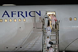 JOHANNESBURG, SOUTH AFRICA - APRIL 26: An SAA flight with a Cuban Health Brigade, consisting of 217 Cuban Health proffesionals arrived at Waterkloof Airforce Base. on April 26, 2020 in Johannesburg South Africa. Under pressure from a global pandemic. President Ramaphosa declared a 21 day national lockdown extended by another two weeks, mobilising goverment structures accross the nation to combat the rapidly spreading COVID-19 virus - the lockdown requires businesses to close and the public to stay at home during this period, unless part of approved essential services. (Photo by Dino Lloyd)