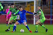 Ryan Loft (#25) of Carlisle United FC holds off Liam Kitching (#20) of Forest Green Rovers and Carl Winchester (#7) of Forest Green Rovers during the The FA Cup match between Carlisle United and Forest Green Rovers at Brunton Park, Carlisle, England on 10 December 2019.