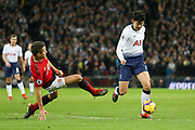 Son Heung-Min forward of Tottenham Hotspur (7) is tackled by Manchester United Midfielder Ander Herrera during the Premier League match between Tottenham Hotspur and Manchester United at Wembley Stadium, London, England on 13 January 2019.