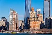 US, New York City. Lower Manhattan seen from the Staten Island ferry. One World Trade Center (Freedom Tower) Under Construction.