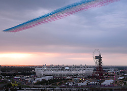 © Licensed to London News Pictures. 27/07/2012. LONDON, UK. The Red Arrows RAF display team flyover the Olympic Stadium to begin the opening ceremony of the 2012 Summer Olympics. Constituting the third time the Olympic Games have been held in Great Britain, the 2012 Olympic Games, also known as the Games of the XXX Olympiad opened this evening with a show, put together by 'Slum Dog Millionaire' director Danny Boyle, entitled 'The Isles of Wonder. Photo credit: Matt Cetti-Roberts/LNP