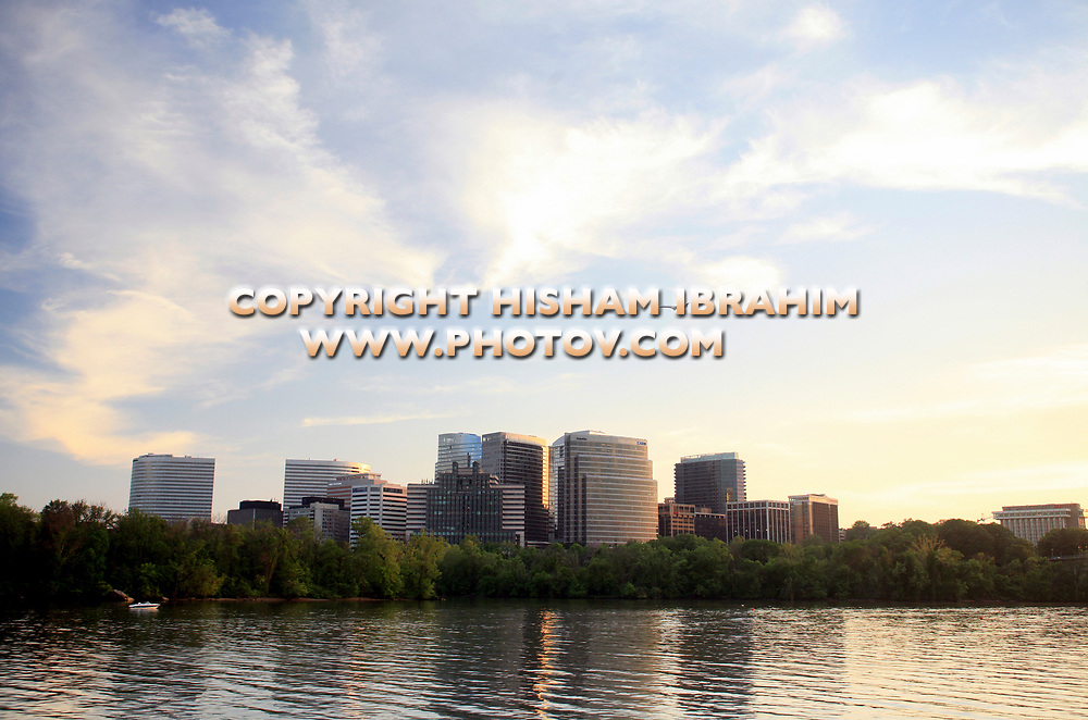 The Skyline of Rosslyn in Arlington County and the Potomac River before Sunset with an airplane flying over, Virginia, USA