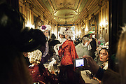 Carnival characters in costume in caffè Florian in Venice during the carnival.