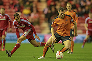 Kevin McDonald (Wolverhampton Wanderers) turns inside the Middlesbrough player during the Sky Bet Championship match between Middlesbrough and Wolverhampton Wanderers at the Riverside Stadium, Middlesbrough, England on 4 March 2016. Photo by Mark P Doherty.