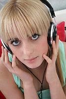 Portrait of teenage girl (16-17) with headphones