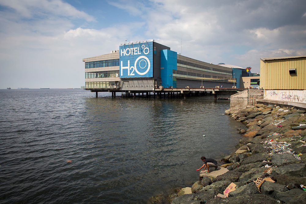 A man fishing in the south harbour of Manila Bay in front of Hotel H2O in Luneta, Manila, Metro Manila, Philippines. The Hotel H2O is part of Manila Ocean Park and supports some life-sized fish tanks.  (photo by Andrew Aitchison / In pictures via Getty Images)