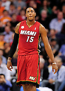 Nov. 17, 2012; Phoenix, AZ, USA; Miami Heat guard Mario Chalmers (15) walks up the court during the game against the Phoenix Suns in the first half at US Airways Center. The Heat defeated the Suns 97-88. Mandatory Credit: Jennifer Stewart-US PRESSWIRE.