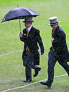 ROYAL ASCOT RACE MEETING THURSDAY - LADIES DAY. .CAUGHT OUT BY THE RAIN.