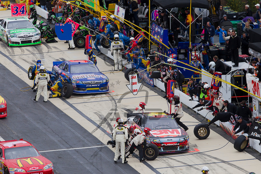 DOVER, DE - OCT 02, 2011:  Greg Biffle (16) and Bobby Labonte (47) come in for pit stops during the AAA 400 race at the Dover International Speedway in Dover, DE.