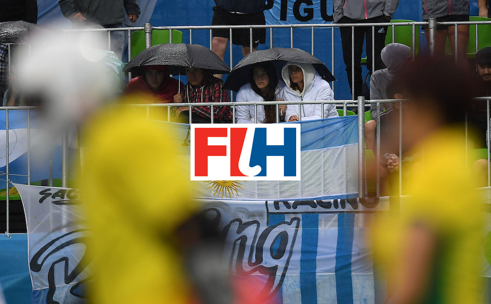 Argentina fans watch the women's field hockey Britain vs Argentina match of the Rio 2016 Olympics Games at the Olympic Hockey Centre in Rio de Janeiro on August, 10 2016. / AFP / MANAN VATSYAYANA        (Photo credit should read MANAN VATSYAYANA/AFP/Getty Images)