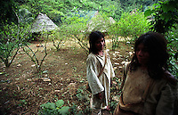 Kogi Indians stand in the village coca field in the Sierra Nevada Mountains, on Colombia?s Caribbean coast in 2004. The Indians in the Sierra Nevada grow and chew coca as part of their culture and tradition. (Photo/Scott Dalton)