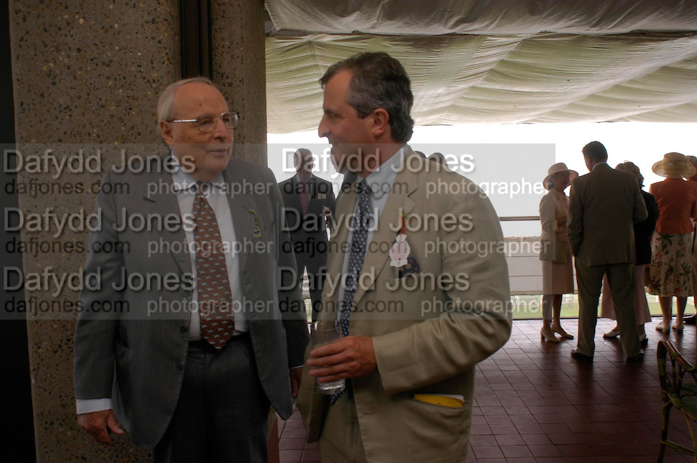 The Duke of Richmond and Lord Astor. Glorius Goodwood. 27 July 2005. ONE TIME USE ONLY - DO NOT ARCHIVE  © Copyright Photograph by Dafydd Jones 66 Stockwell Park Rd. London SW9 0DA Tel 020 7733 0108 www.dafjones.com