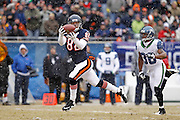 Greg Olsen (82) of the Chicago Bears makes a 58-yard touchdown reception in the first quarter behind Lawyer Milloy (36) of the Seattle Seahawks in the NFC Divisional Playoff game on Jan. 16, 2011 at Soldier Field in Chicago, Illinois. The Bears won 35-24. (Photo by Joe Robbins)