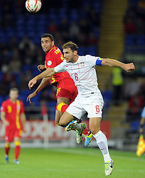 Hal Robson-Kanu of Wales (Reading) battles for the high ball with Branislav Ivanovic of Serbia (Chelsea)  - Photo mandatory by-line: Joe Meredith/JMP - Tel: Mobile: 07966 386802 10/09/2013 - SPORT - FOOTBALL - Cardiff City Stadium - Cardiff -  Wales V Serbia- World Cup Qualifier
