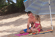 A father and daughter on the beach on Oahu's north shore in Hawaii
