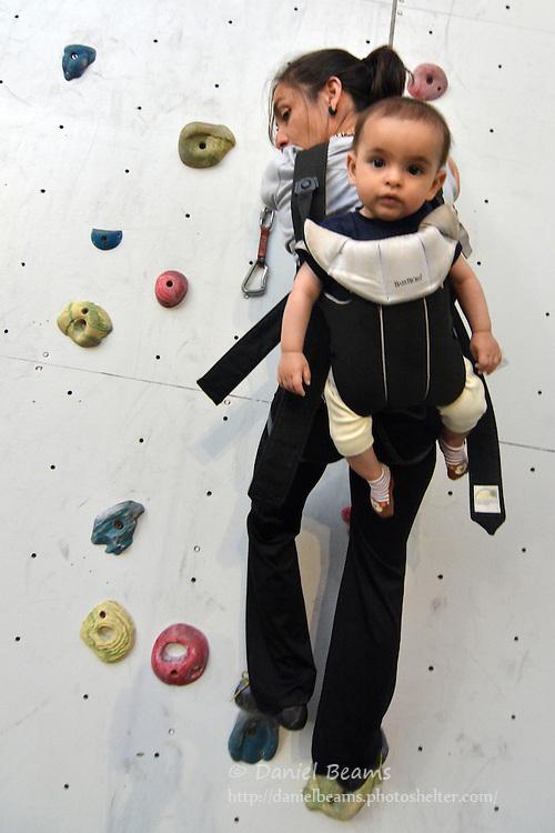 Rock climbing wtih baby in backpack, Lima, Peru
