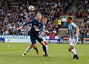 Christian Eriksen of Tottenham shadowed by Huddersfield Town's Jonathan Hogg during the Premier League match between Huddersfield Town and Tottenham Hotspur at the John Smiths Stadium, Huddersfield, England on 30 September 2017. Photo by Paul Thompson.