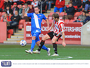 Andy Drury and Kyle Storer during the Vanarama National League match between Cheltenham Town and Eastleigh at Whaddon Road, Cheltenham, England on 17 October 2015. Photo by Antony Thompson.