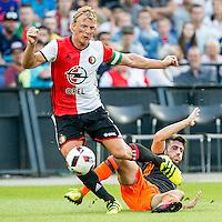 ROTTERDAM - Feyenoord - Valencia , Eredivisie, Voetbal, Seizoen 2016-2017, Feyenoord stadion de Kuip23-07-2016 , Feyenoord speler Dirk Kuyt (l) wordt onderuit gehaald door Valencia speler Fernando Garcia (r)