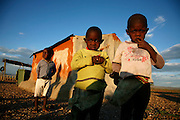 Young african boys sit outside their home in Damaraland. Namibia..© Zute and Demelza Lightfoot.www.lightfootphoto.com