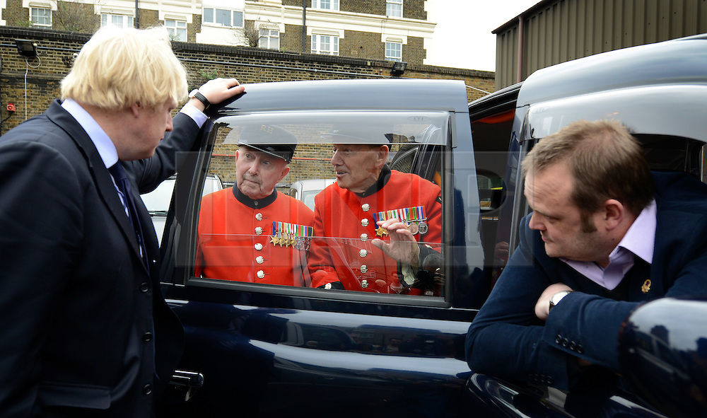 © Licensed to London News Pictures. 02/05/2012. London, UK London Mayor, Boris Johnson (L) is joined by comedian Al Murray (sitting) to wave off an army of WWII veterans who are embarking on an iconic trip to the Netherlands, via a convoy of black cabs. The London Taxi Benevolent Association for the War Disabled has organised a trip for 160 WWII veterans to travel to Holland in 80 London Black Cabs. The veterans, mostly aged between 85 and 94, will start their journey from London today 2nd May 2012 and will be visiting sites of importance from WWII and taking part in Dutch Liberation Day celebrations as guests of honour of the Dutch Royal Family.. Photo credit : Stephen Simpson/LNP